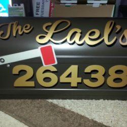 gold vinyl lettering on black mailbox