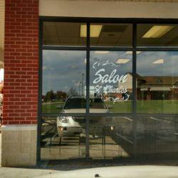 Salon St. Charles vinyl lettering - white script on window