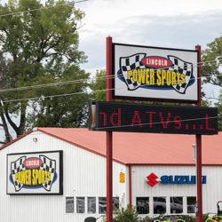 Lincoln Power Sports box sign and EMC digital display