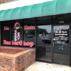 No Hatz BarberShop red vinyl lettering