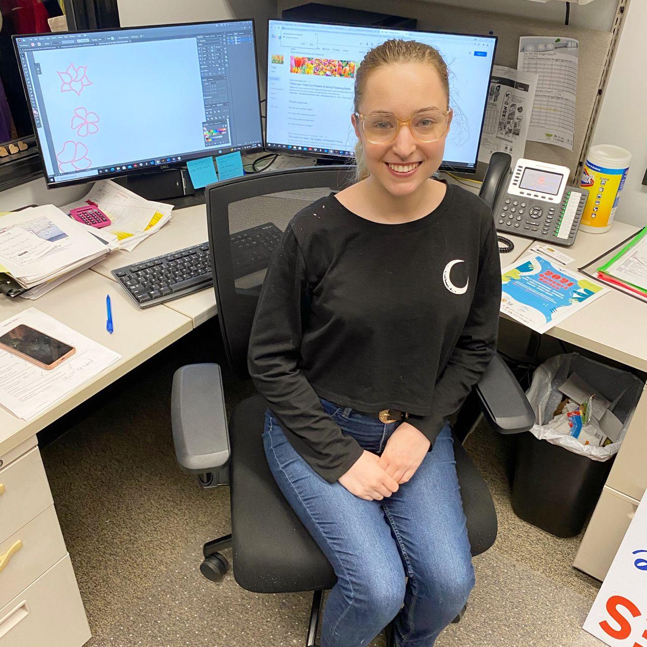 Maddie sitting at her desk